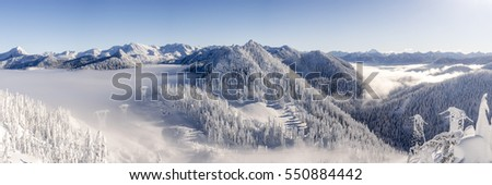 Cascade Mountain Range Panorama with Ice Cold Winter Snow and Hazy Blue Sky #550884442