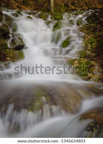 Cascade stream in forest.Stream flow long exposure