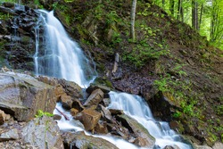 Cascade Trufanets Falls in Carpathian mountains- the highest natural waterfall in Transcarpathia at summer. Ukraine.