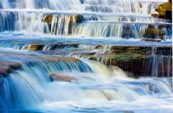 Cascades at Albion. Albion Falls is a 19-meter-high cascade waterfall. Cascade waterfalls flow over a series of steps, causing water to