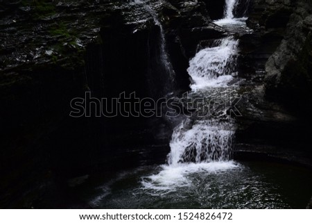 Cascading water down rough rock. ストックフォト ©