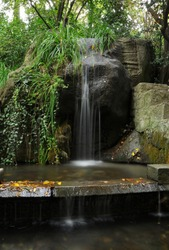 Cascading waterfalls among the stones in the summer Green Park