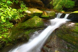 Cascading waters of the Lower Caney Creek Falls in the Bankhead National Forest of Alabama