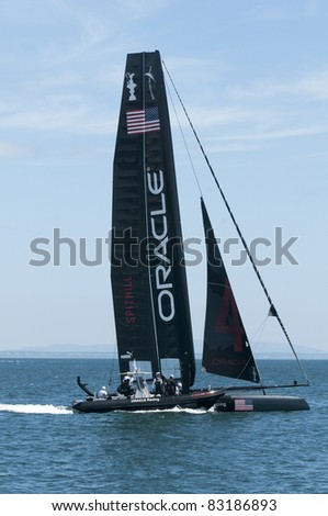 "CASCAIS, PORTUGAL - AUGUST 14: Team Oracle Racing, in boat No. 4, from the United States, participates in the America's Cup AC World Series ""Live Racing"" on August 14, 2011 in Cascais, Portugal."