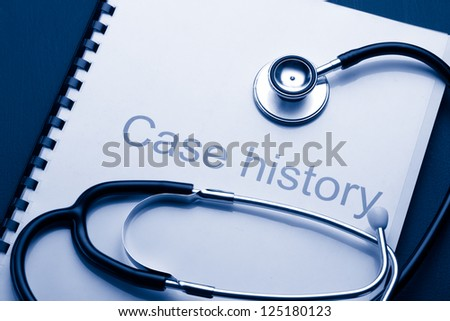 Case history and stethoscope on black