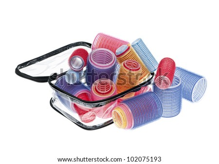 Case of colorful hair rollers isolated on white background