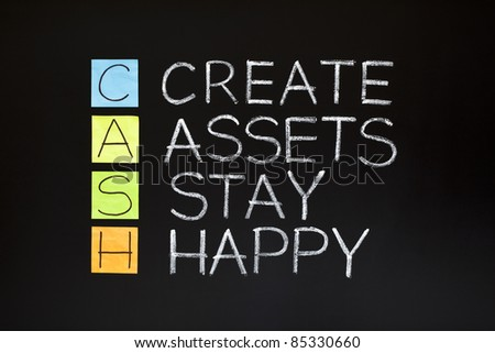 CASH acronym - CREATE ASSETS STAY HAPPY made with sticky notes and white chalk on a blackboard.
