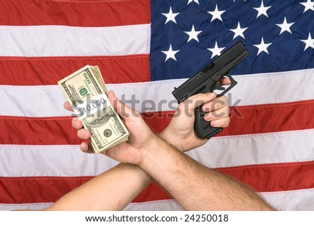 Cash and a gun held against the American flan, a symbol of many things in America such as terrorism, hangs, crime and opportunity