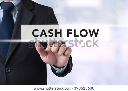 CASH FLOW CONCEPT Businessman hands touching on virtual screen and blurred city background #398623630