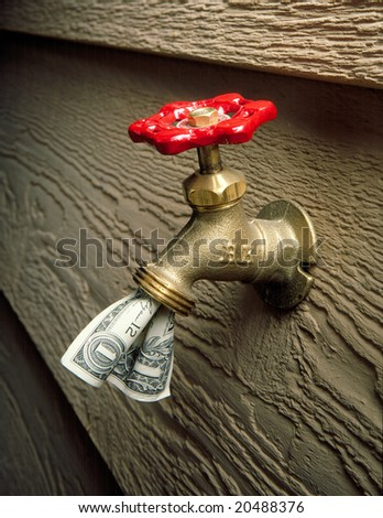 Cash Flow - Money coming out of Faucet - stock photo