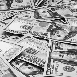 Cash hundred dollar bills, dollar background image. Scattered dollars. A big pile of dollars. Background of North American dollar bills. Black and white style. Top view for collage