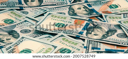 Cash hundred dollar bills, dollar background image. Scattered dollars. A big pile of dollars. Background of North American dollar bills. Color style. Top view for collage and presentation editing.