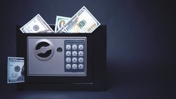 Cash Money Safe Deposit. Symbol of wealth and safety. Small Residential Vault with protruding dollars. Toned soft focus picture. Copy space
