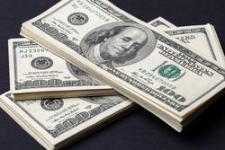 Cash of hundred dollar bills, dollar background.