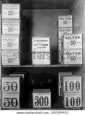 Cash vault of the United States Treasury holds packages of Gold and Silver certificates worth over 80 million dollars. In 1914, the U.S. was on a bimetallic standard.