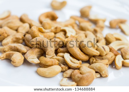 cashew nuts isolated on white, close up