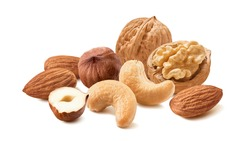 Cashew, walnut, hazelnut and almond nuts isolated on white background. Trail mix. Package design element with clipping path. Horizontal layout
