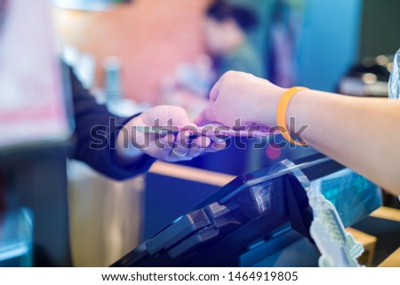 Cashier take banknote from consumer hand. Hand Paying Money To Worker In Coffee shop. Saleswoman receiving payment from male customer in store.