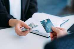 Cashless payment. Money transfer. Bank account. Online currency transaction. Man exchanging credit card for cash.