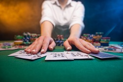 Casino background, online poker and big bets. Player plays in a night club.