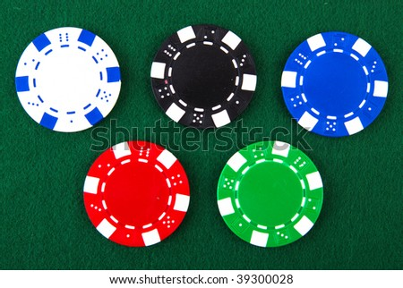 Casino chips each different color on green felt