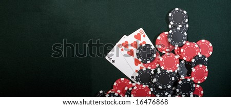 Casino chips on a green background and texas holdem poker cards. Vegas concept