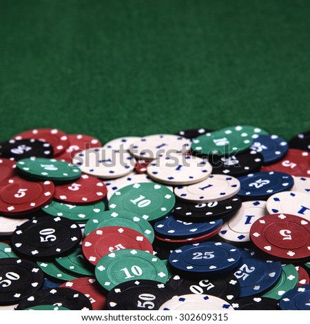 Casino chips on a green table background