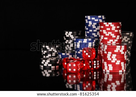 Casino chips on black background