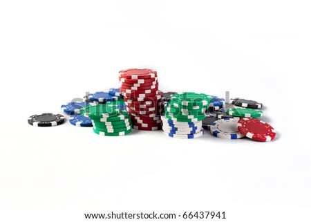 Casino colorful chips isolated on white background with copyright space
