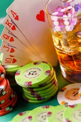 Casino concept - dice in cocktail glass on the gambling table