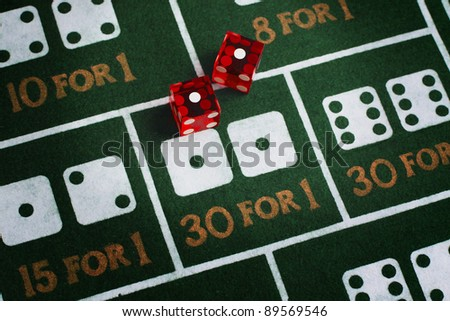 Casino dice roll snake eyes on a craps table felt