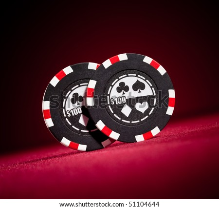 Casino gambling chips on the red - stock photo