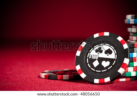 Casino gambling chips with copy space. - stock photo