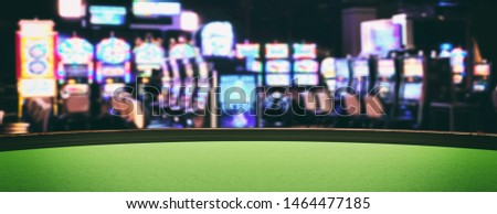 Casino interior, slot machines concept. Roulette table with green felt, blur slot machines room background, banner, copy space. 3d illustration