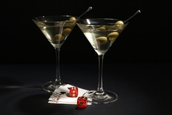 Casino playing cards, dice and cocktail on black table. Four of a kind poker combination
