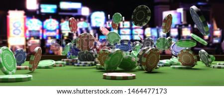 Casino poker concept. Poker chips falling on green felt roulette table, blur slot machines room interior background, banner. 3d illustration