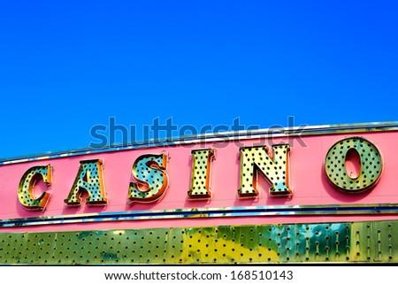 casino sign over blue sky.