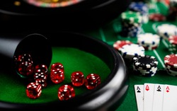 Casino symbols composition. Roulette wheel, poker chips, dice, cards. Recreation and entertainment concept.