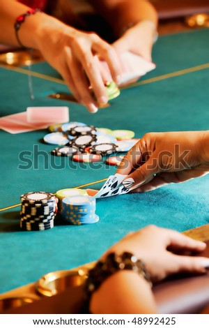 Casino table with hands