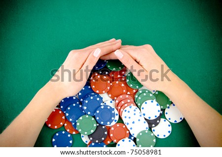 Casino win, gambling chips taken by hands