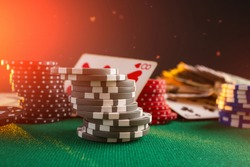 Casinos, chips on the gaming table, against the background of poker chips and money. Background for the gaming business