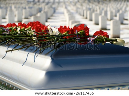 Casket  with flowers on top graveside at Arlington National Cemetery