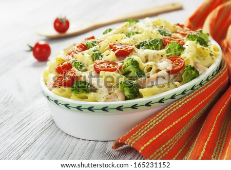 Casserole pasta with chicken and broccoli on the table