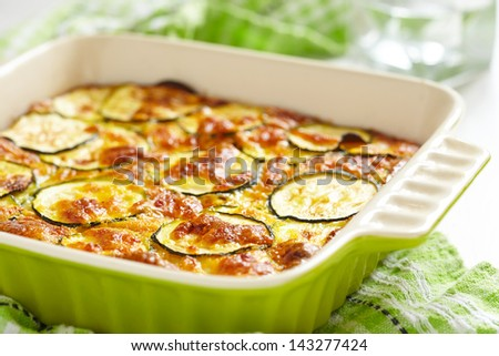 casserole with cheese and zucchini in baking dish