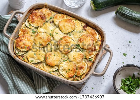 Photo of  casserole with cheese and zucchini in baking dish