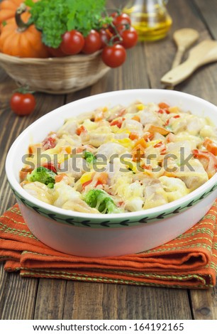 Casserole with chicken fillet and vegetables on the table