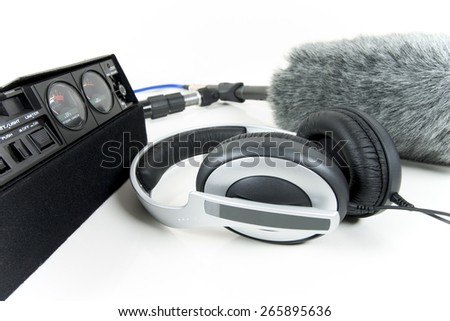 Cassette recorder, boom mic and headphones over white