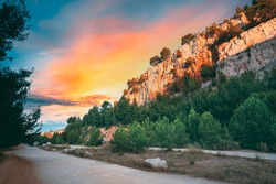 Cassis, Calanques, France. French Riviera. Beautiful Nature Of Cote De Azur On The Azure Coast Of France. Calanques - A Deep Bay Surrounded By High Cliffs. Altered Sunset Sky. Road To Bay.