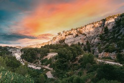 Cassis, Calanques, France. French Riviera. Beautiful Nature Of Cote De Azur On The Azure Coast Of France. Calanques - A Deep Bay Surrounded By High Cliffs. Altered Sunset Sky.
