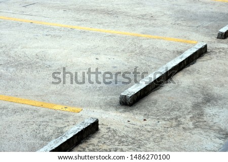 Cast-cast concrete Used to block the car tires in the parking lot of the department store
